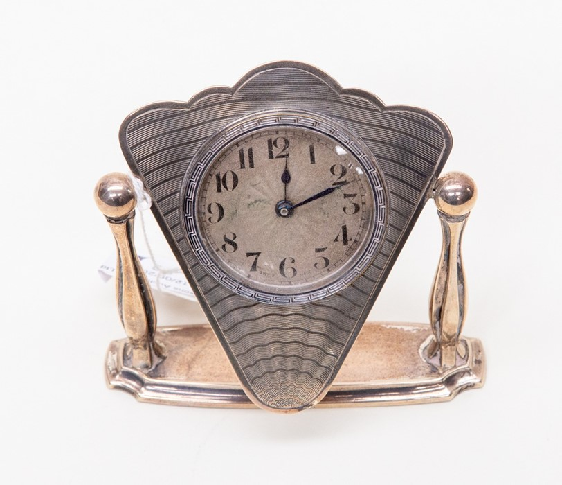 Lot 36 - A silver table clock with engine turned detail on face, on swivel stand Birmingham silver 1931 by S