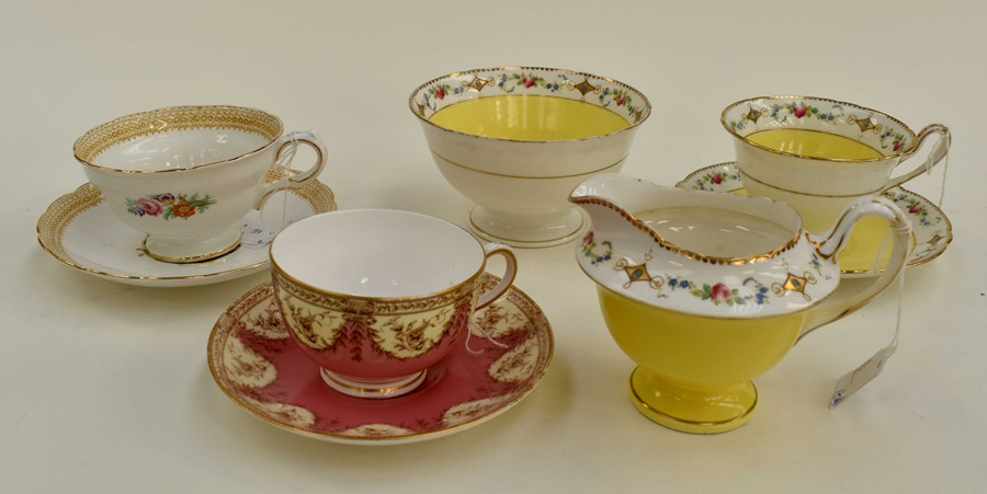 Lot 1068 - A small collection of ceramics to include; Shelley painted cup and saucer, yellow ground A8901/3,