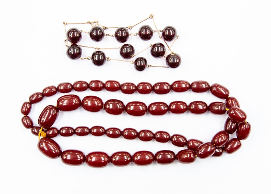 Lot 353 - A cherry amber graduated oval bead necklace, largest bead approx 24mm x 15mm, smallest approx 12mm x