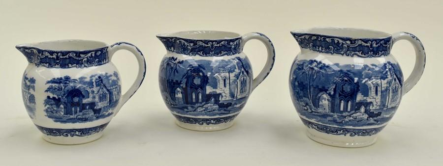 Lot 1036 - George Jones Abbey three graduated jugs