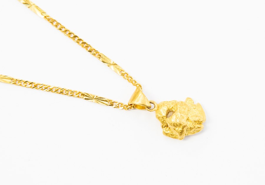 Lot 294 - An Australian gold nugget pendant on Chinese 22ct gold chain, weight approx 20 grams