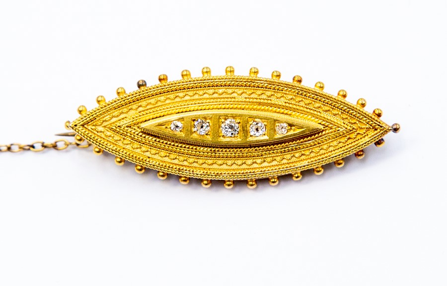 Lot 276 - A Victorian 15ct gold mourning brooch, Etruscan style marquise shaped with five graduated diamonds