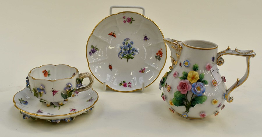 Lot 1053 - Meissen tea cup, saucer and saucer with relief form and insect detail plus a Continental jug with