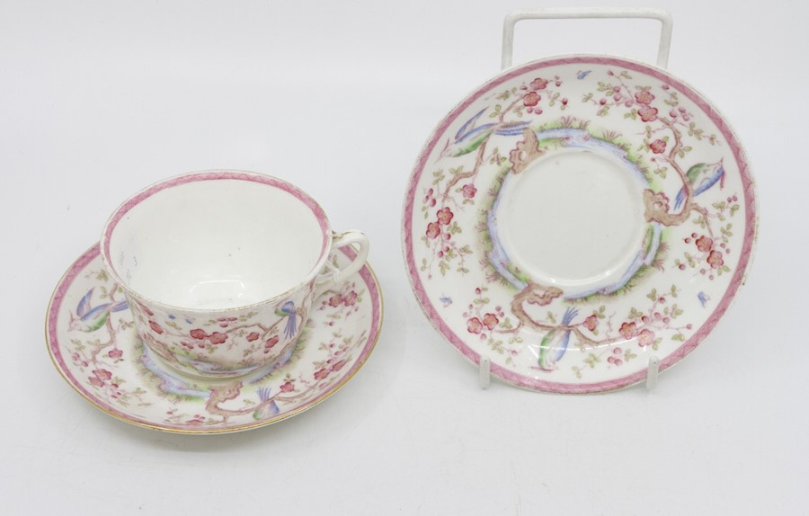 Lot 1005 - **MERGE** An Adderleys cup and saucer, along with another saucer decorated with exotic birds and
