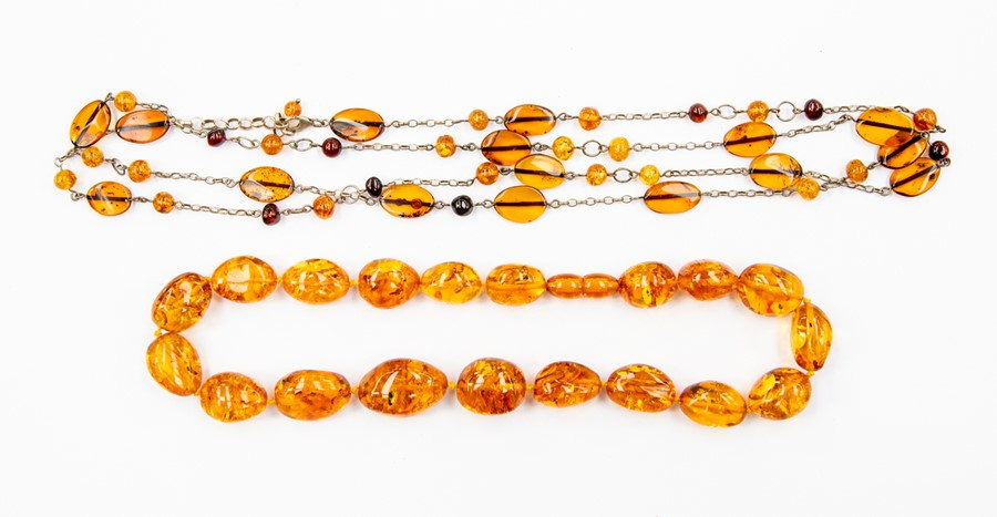 Lot 351 - An amber bead necklace, oval beads, bead barrel clasp, length approx 19.5'', total gross weight