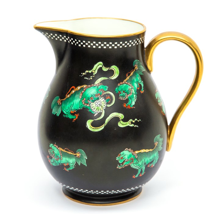 Lot 1003 - An early 20th Century Wedgwood jug decorated with green dragons