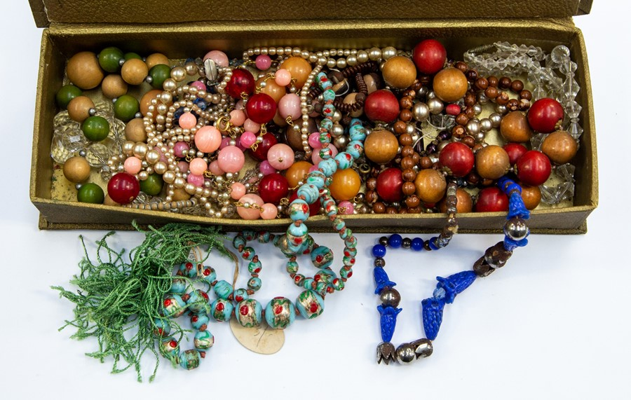 Lot 385 - Chinese 1920's bead necklace and other necklaces within vintage chocolate box (Q)