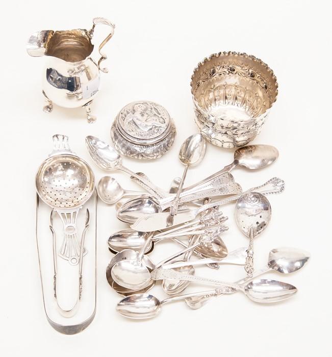 Lot 51 - A quantity of silver including a late Victorian silver Britannia standard cream jug, on three trefit