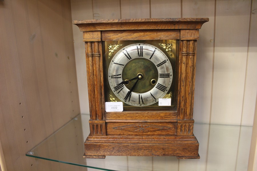 Lot 4022 - A 1930's 8 day strike oak cased mantel clock and a similar 1930's quartz movement oak cased mantel