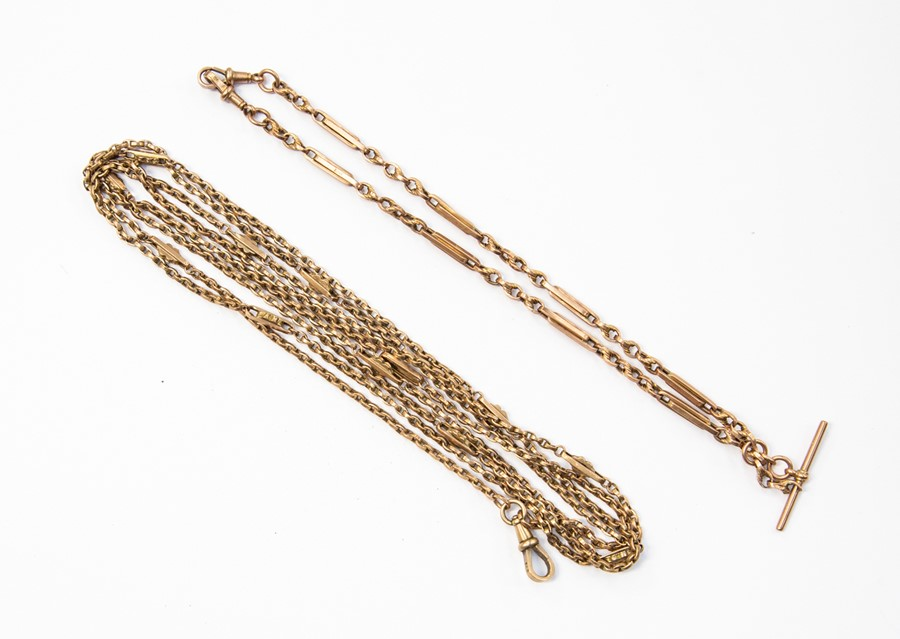 """Lot 289 - An Edwardian 9ct long guard chain, length approx. 62"""" and a 9ct fancy link watch chain, length"""