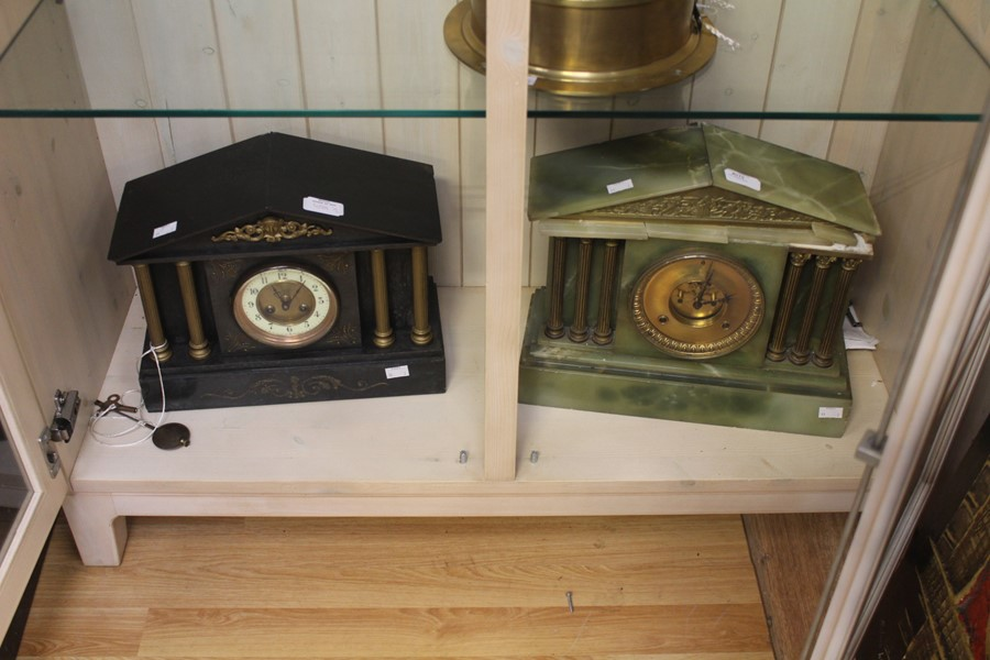 Lot 4019 - A Victorian gilt metal mantel slate 8 day striking mantel clock, temple shaped, together with a