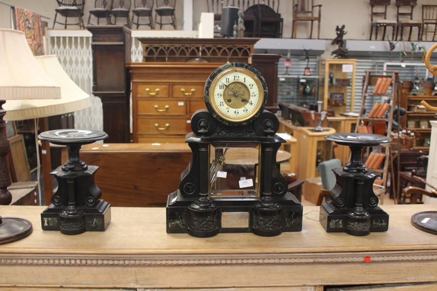 Lot 4042 - An Edwardian slate front escapement barrel clock, with garniture