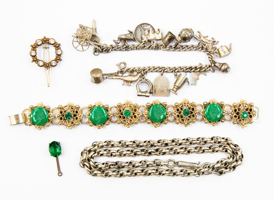 Lot 337 - A collection of costume jewellery to include a white metal fancy link chain and a charm bracelet