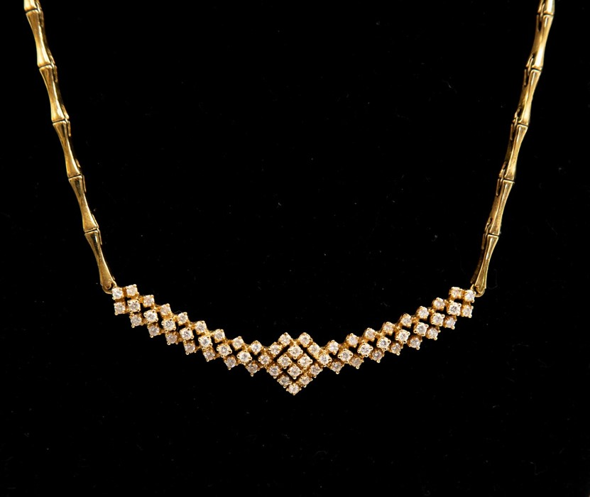 Lot 298 - A diamond necklace, diamond set cluster detail set to the front to a bamboo link chain in 18ct gold,