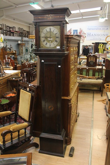Lot 4041 - A brass faced 30 hour long case clock by Samuel Graves, circa 1730. Bird cage movement and inlaid