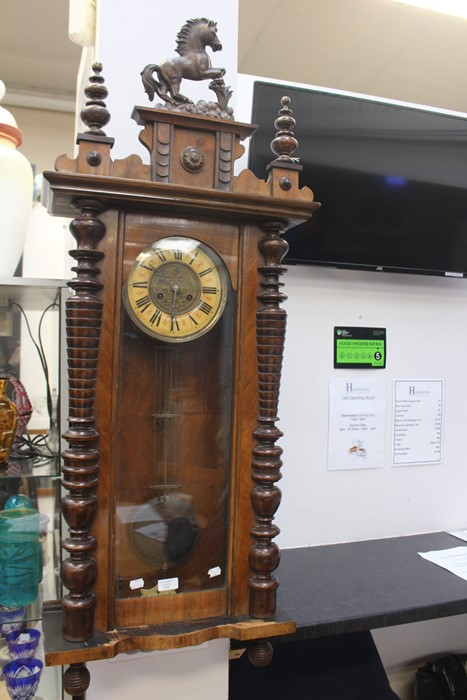 Lot 4015 - A late 19th Century/early 20th Century walnut Vienna wall clock, prancing horse finial, key and