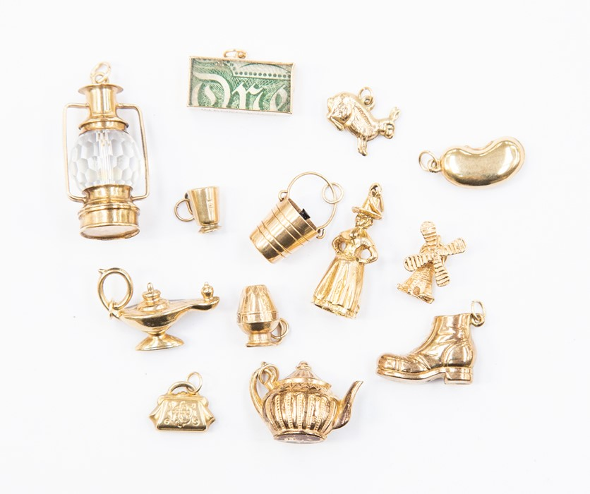 Lot 304 - Thirteen assorted charms, comprising nine 9ct gold versions, with a combined total gross weight