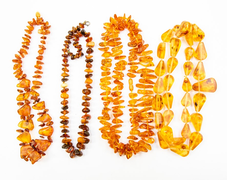 Lot 356 - A collection of various amber bead necklaces, comprising pear shaped and chip style beads, total