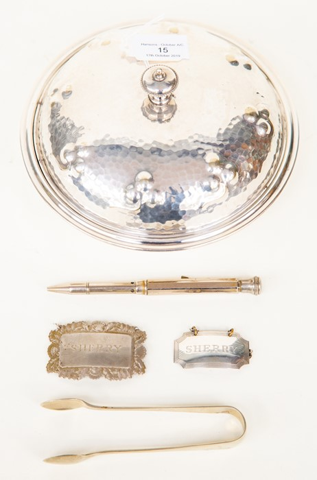 Lot 15 - A Mappin & Webb muffin dish, sherry drink label x2, tongs, propelling pencil (5)