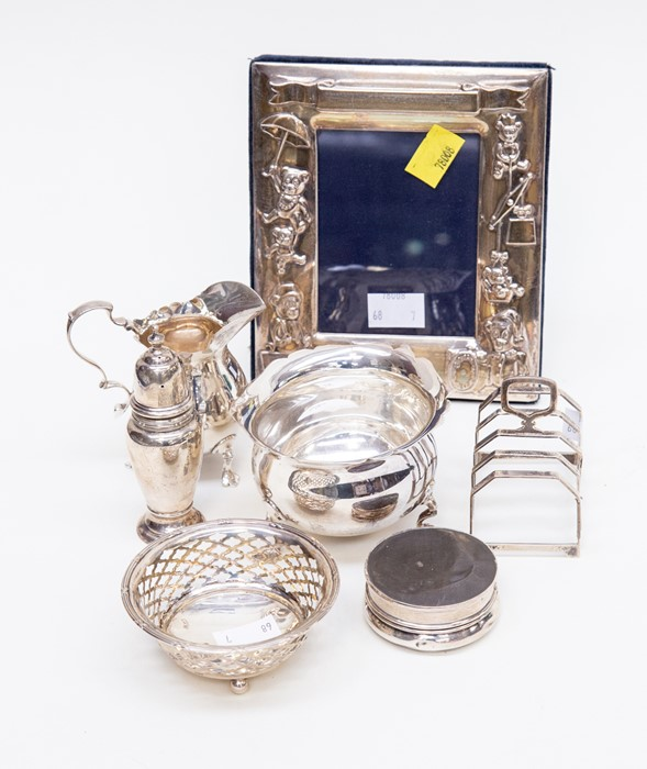 Lot 46 - A collection of early 20th Century silver including a matching sugar bowl and cream jug, on three