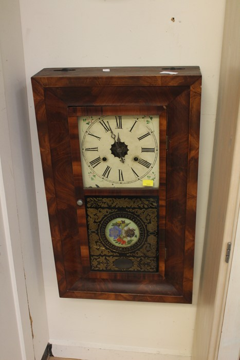 Lot 4044 - An Art Deco mahogany wall hanging glazed clock with roman numerals.