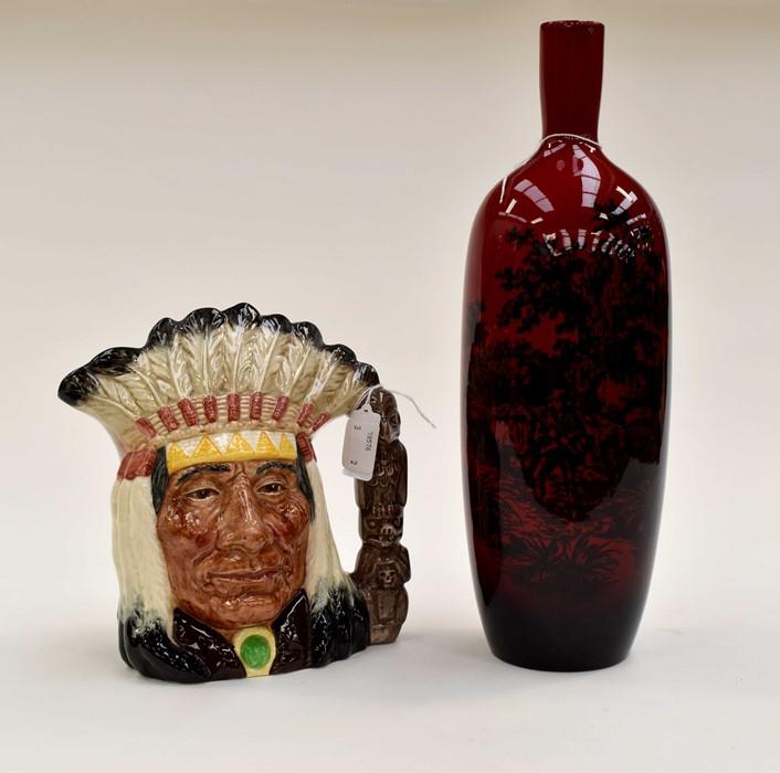 Lot 1051 - Royal Doulton flambé woodcut 1617 vase, 35cm high and North American Indian character jug D6611,