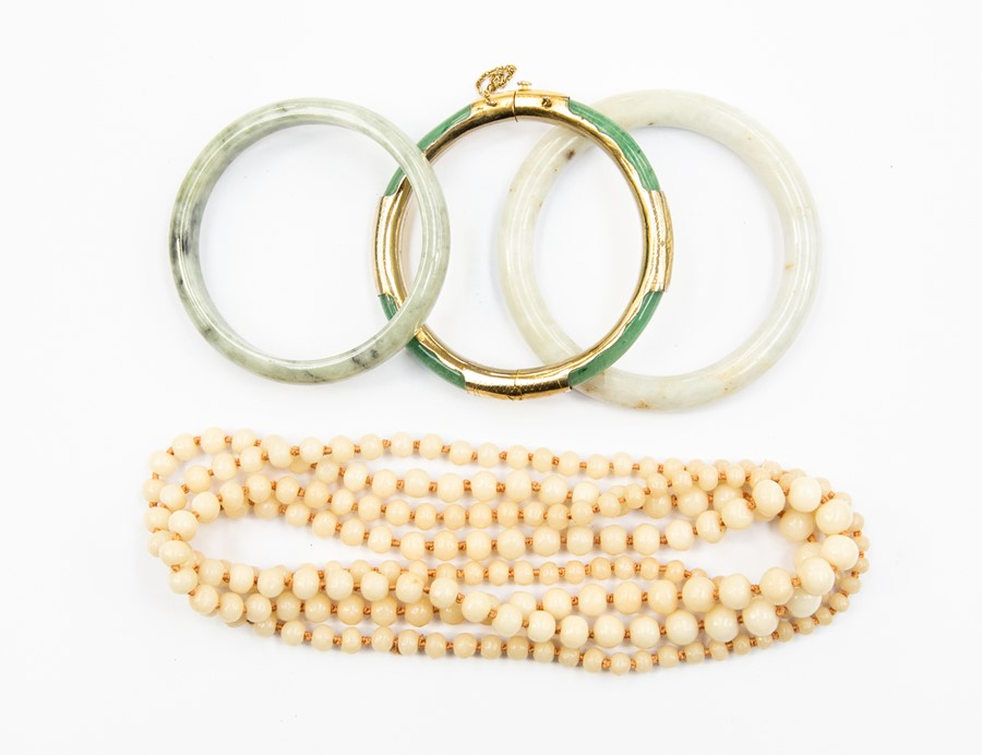 Lot 349 - **REOFFER IN A&C NOV £40-£50** Three jade type bangles comprising white and green versions, one with