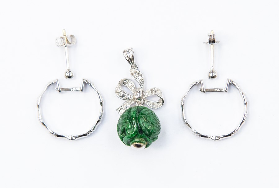 Lot 318 - A pair of 18ct white gold hoop earrings and an 18ct white gold pendant suspending carved jadeite