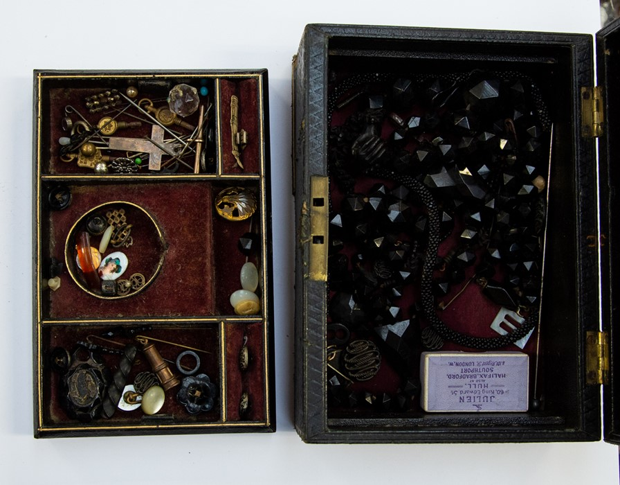 Lot 386 - Whitby Jet, French Jet, hat pins, pins, watch keys etc all in a vintage leather jewel box