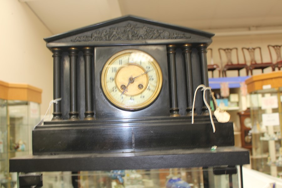 Lot 4038 - A German slate mantle clock, early 20th Century, complete with key