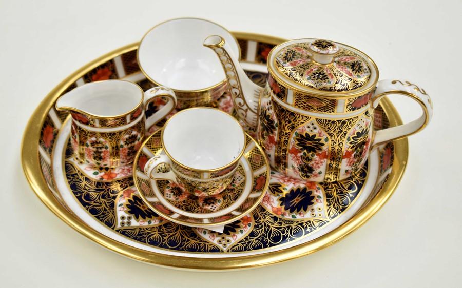 Lot 1029 - Miniature Royal Crown Derby Imari 1128 coffee tea set comprising, tray coffee pot, sugar bowl, cup