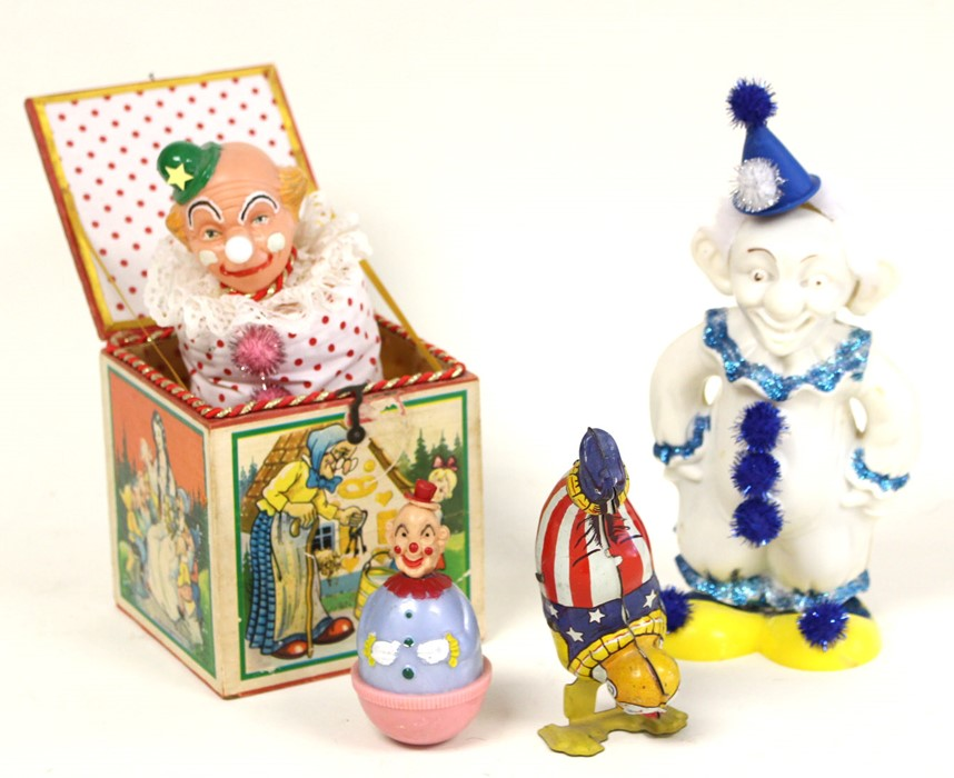 Lot 28 - Clowns: A collection of four unboxed tinplate/plastic clowns to comprise: Clown Jack in a Box,
