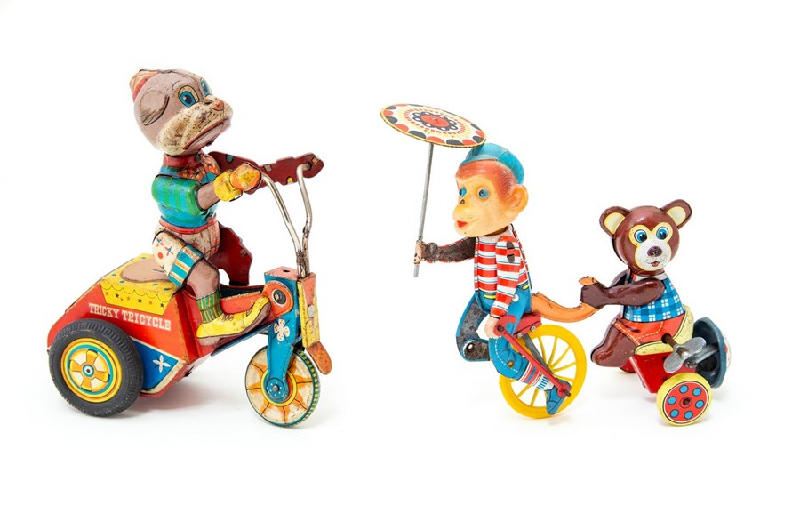 Lot 44 - Cycling Chimp: A clockwork, tinplate, Cycling Chimp Pulling a Bear, Made in Japan, length approx.