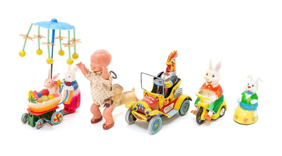 Lot 48 - Rabbit: A celluloid, Rabbit on Tricycle, Made by Happy Easter, Hong Kong, length approx. 9cm;