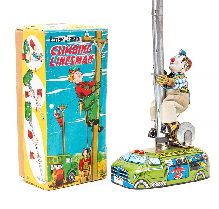 Lot 11 - Climbing Linesman: A boxed, mid-20th century, battery operated, tinplate, Climbing Linesman, Made by