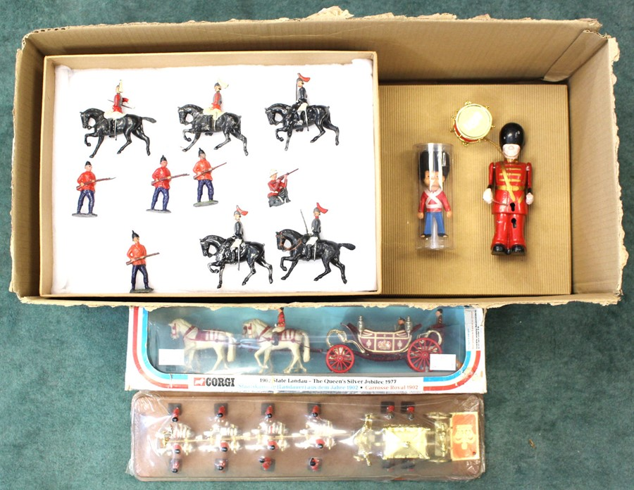 Lot 29 - Lead Soldiers and Royal Coaches: A collection of assorted lead soldiers, contained within four small