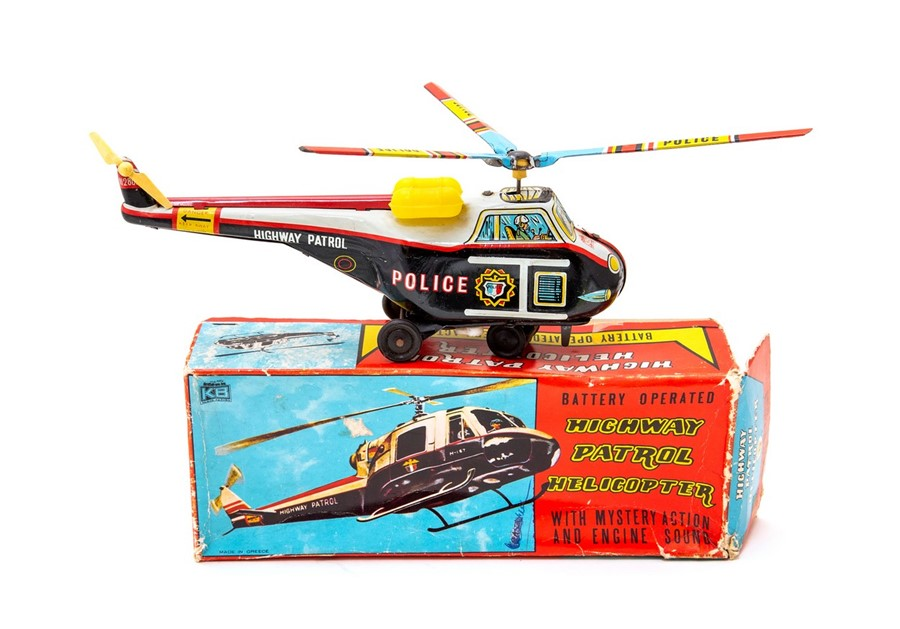 Lot 55 - Highway Patrol: A boxed, battery operated, tinplate, Highway Patrol Helicopter with Mystery Action