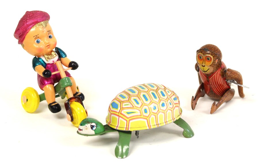Lot 26 - Tinplate: An unboxed clockwork, tinplate, Tumbling Monkey, working, complete with key, length