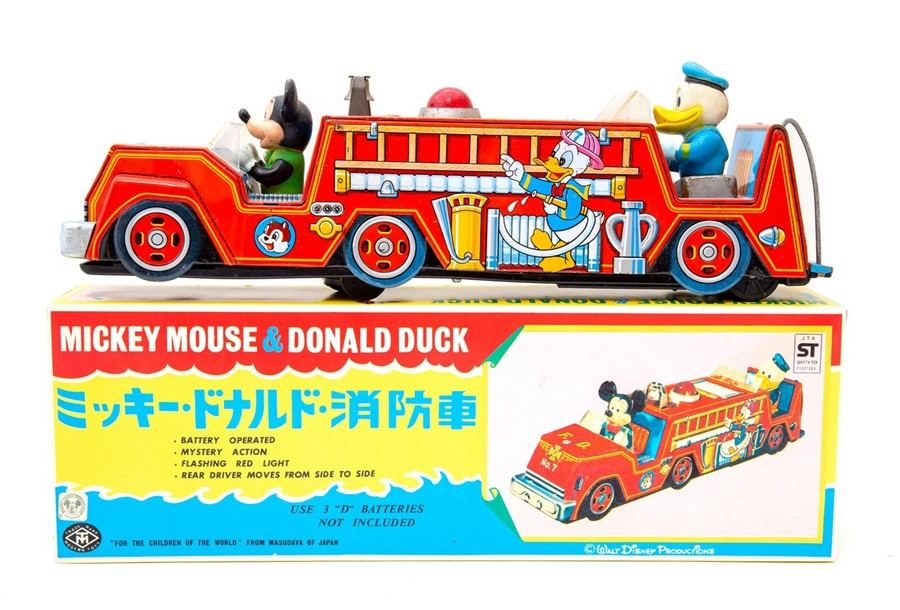 Lot 62 - Mickey Mouse: A boxed, battery operated, tinplate, Mickey Mouse & Donald Duck Fire Engine, Made by