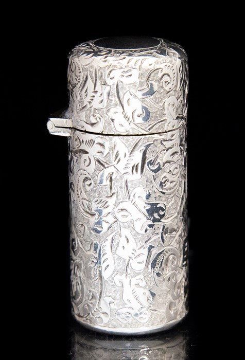 Lot 20 - A late Victorian silver perfume bottle, the body profusely engraved with trailing foliage, the