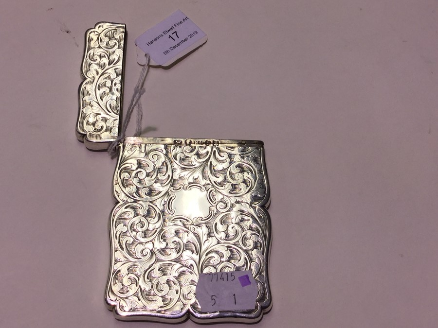 Lot 17 - An early Victorian silver card case, the body profusely engraved with scrolling foliage, by