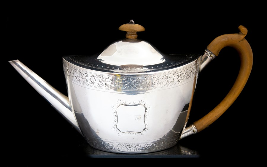 Lot 27 - William Frisbee & Paul Storr: A George III silver Neo-Classical teapot, the body and cover bright-