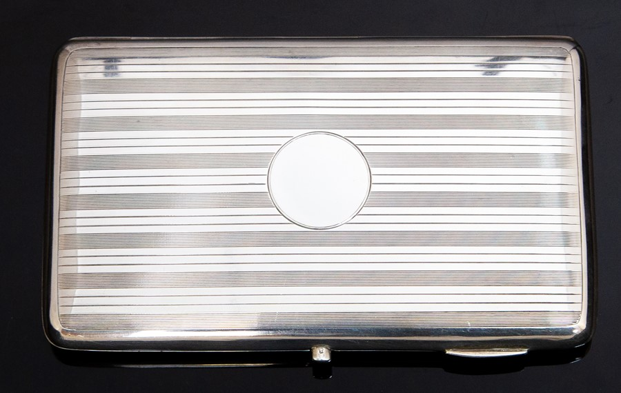 Lot 24 - A George V large silver cigarette case, engraved with striated pattern and vacant circular
