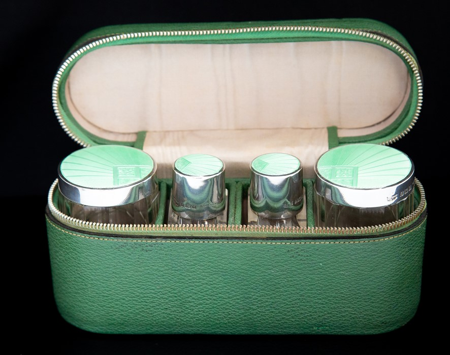 Lot 15 - An Art Deco silver and guilloche enamel travelling toilet set including a pair of cologne/perfume