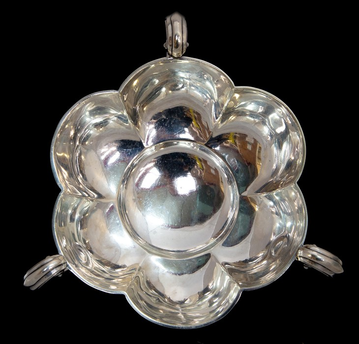 Lot 18 - An Edwardian silver three handled tasting dish, lobed body with double C-scroll handled on stud
