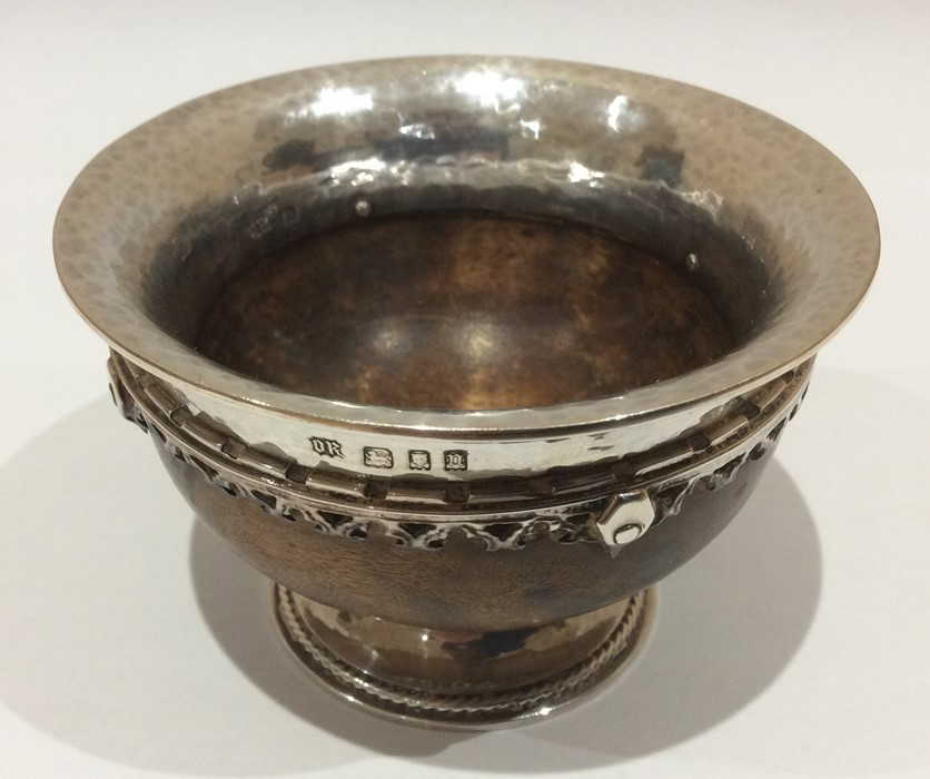 Lot 9 - Omar Ramsden; A George V Arts and Crafts Sterling silver mounted miniature mazer bowl, London