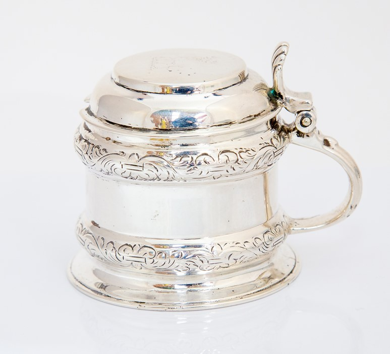 Lot 26 - A George III London silver mustard pot and cover, cylinder shaped with raised scrolling border