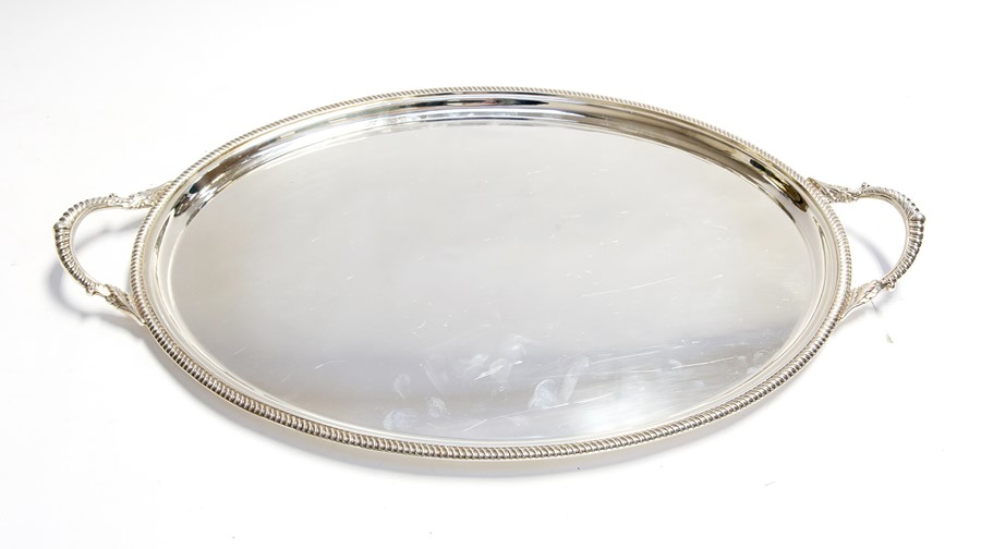 Lot 31 - An Elizabeth II oval two handled silver tray, plain with gadroon border, by Barker Ellis Silver