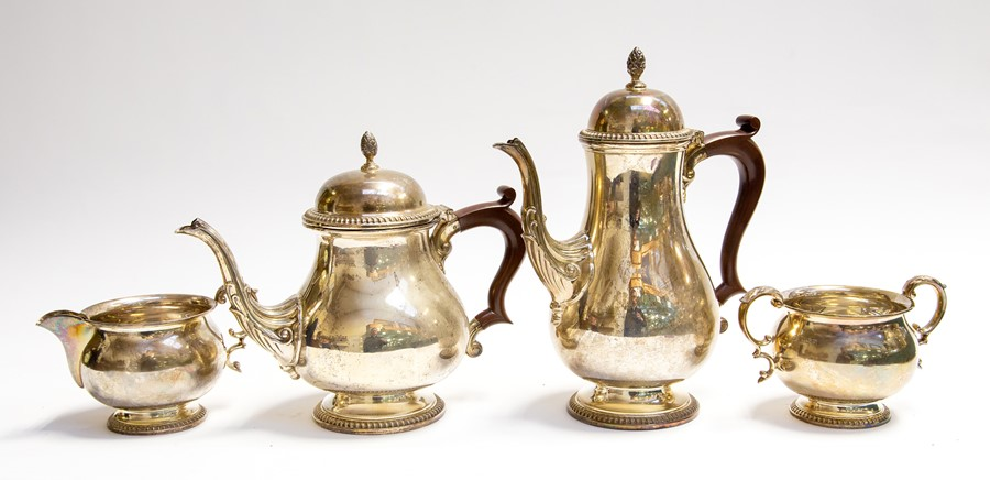Lot 22 - A Georgian style matched four piece silver tea and coffee service, plain bodies on circular feet