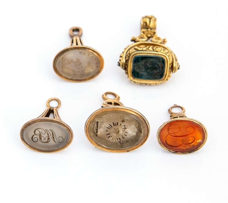 Lot 52 - Five 19th century yellow metal and hardstone seal fobs, one inscribed 'MB' probably Michael